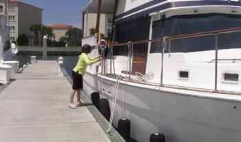 DOCKING.... I have owned trailerable outboard boats, how do I learn to dock a bigger cruising boat?