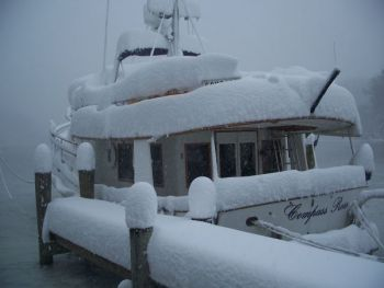 Icebreaker!!!!! Would you believe there is a Kadey Krogen Trawler under that snow?