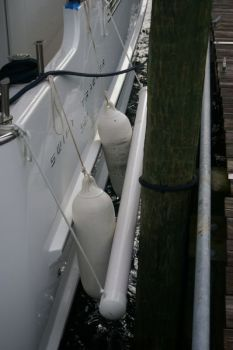 Fenderboards keep your fenders in place against your hull when docked alongside a piling. This fenderboard is actually a schedule 40 thick wall PVC pipe. More often it is made from a wood plank.