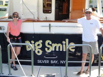 After backing in this BIG single engine boat, BIG SMILES all around ready to meet their new dock neighbors!